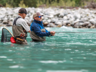 Guide and client chatting on the river