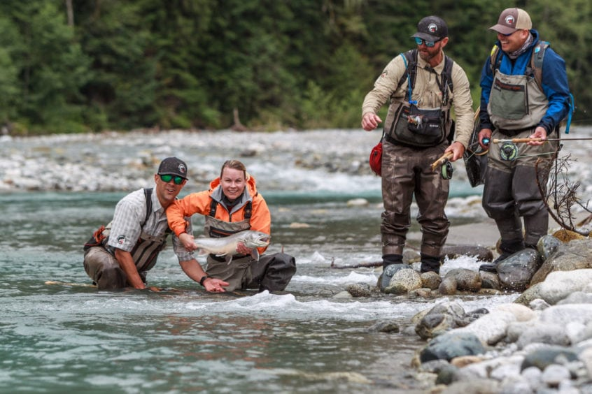 Group of guides and anglers admiring a nice bull trout
