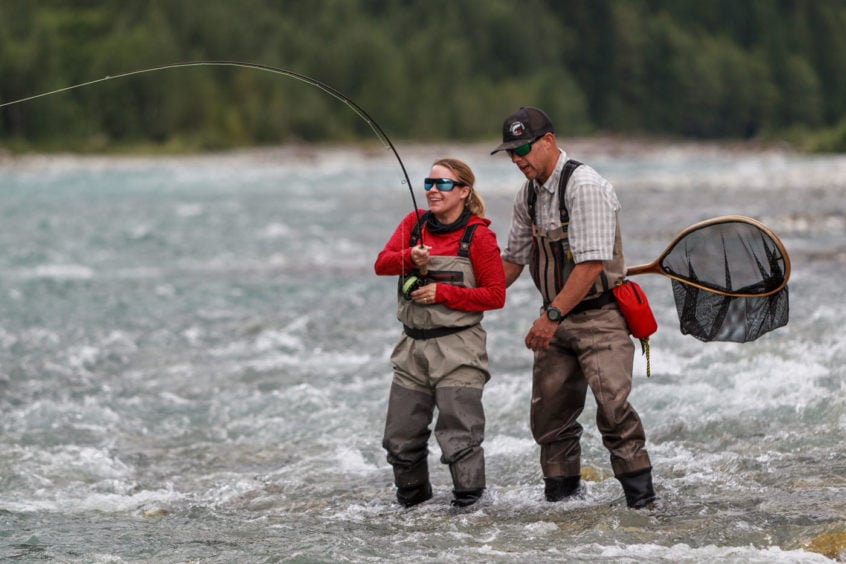 Fighting a large bull trout on the fly
