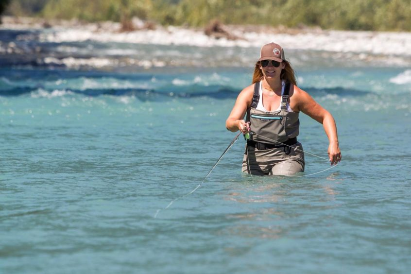 Woman fly fishing in BC