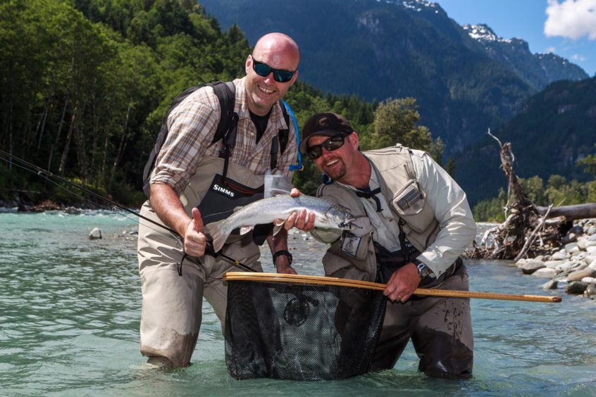 Catching fish on a past heli fishing trip in B.C.