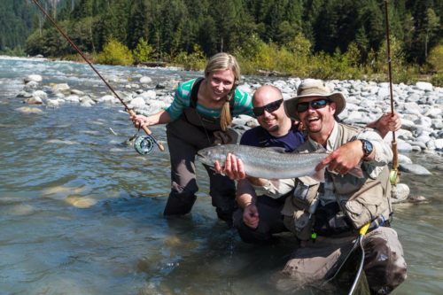 Fly fishing for salmon and trout on a past heli-fishing trip