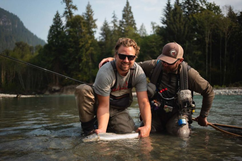Admiring a Bull Trout Caught in Squamish