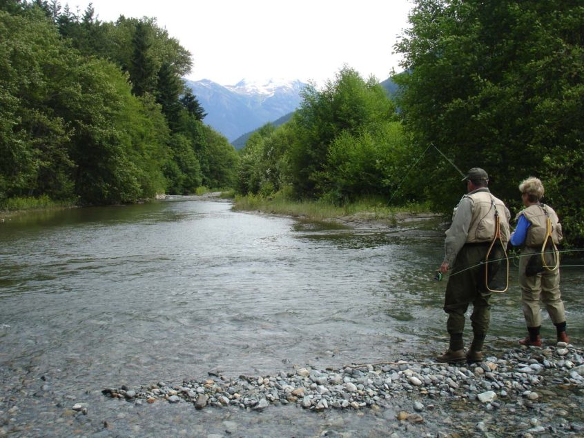 Couple fly fishing near Whistler BC