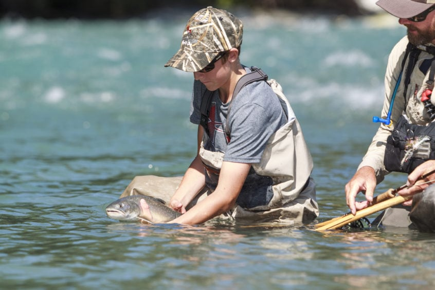 Young Angler with a nice Bull Trout - Heli-Fishing