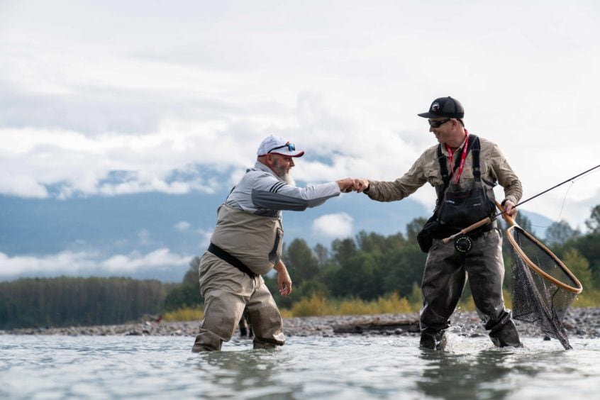 Fist bumps on the river